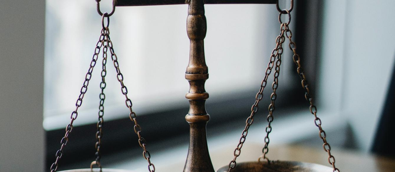 justice scales and gavel on tabletop