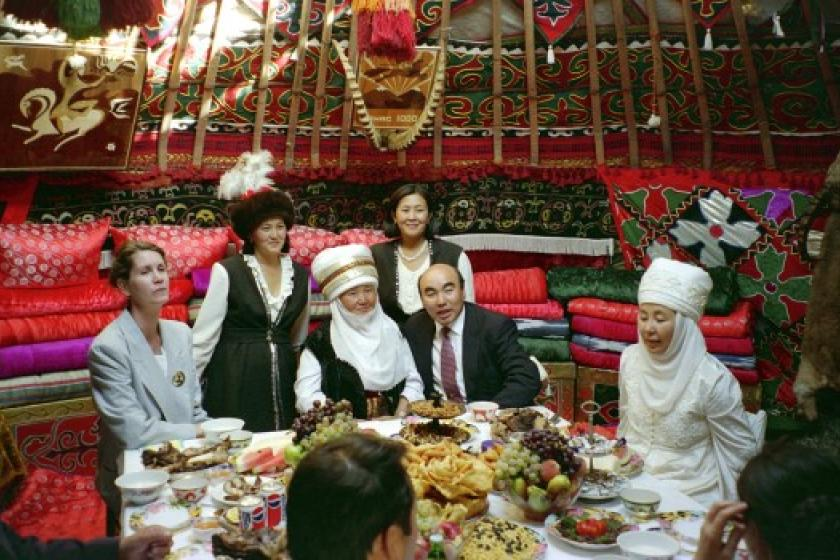 People at a banquet in a yurt